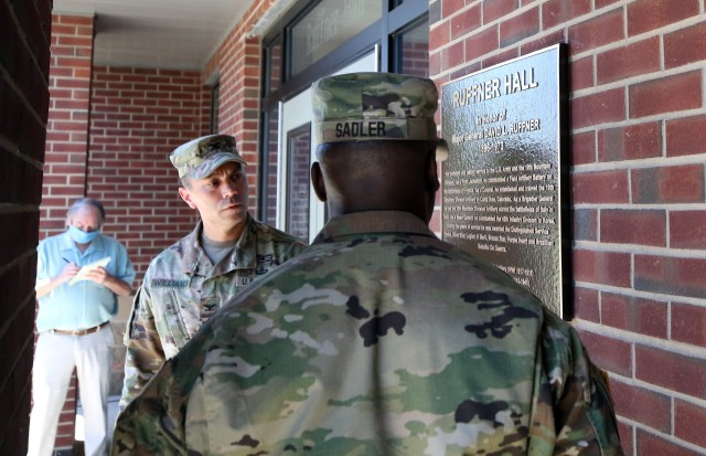 Col. Jason Williams, current commander of the 10th Mountain Division (LI) Artillery, and Command Sgt. Maj. Jimmy Sadler, 10th Mountain DIVARTY's senior enlisted leader, unveil a bronze plaque that signified the rededication of the DIVARTY Headquarters as Ruffner Hall, June 19, 2020 on Fort Drum, N.Y. Ruffner, who was at the time of his command of the unit a Brigadier General, led the Soldiers of 10th Mountain Division's Artillery across the battlefields of Italy in WWII. (U.S. Army photo by Pfc. Anastasia Rakowsky)