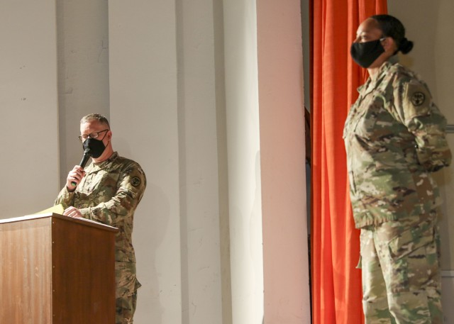 Col. Michael Weber, commander, Landstuhl Regional Medical Center, makes remarks highlighting the efforts by Col. Stacy Freeman (right), who relinquished command of Wiesbaden Army Health Clinic during a change of command and responsibility ceremony, June 12.