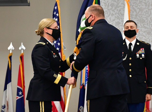 Brig. Gen. Heidi Hoyle, the Military Surface Deployment and Distribution Command's 22nd commanding general, takes the guidon from Gen. Stephen Lyons, commander of U.S. Transportation Command June 23, 2020 during a change of command ceremony at Scott Air Force Base, Illinois. With a Surface Warrior workforce of over 5,000 transportation professionals and nine total force transportation brigades located throughout the world, SDDC moves, deploys and sustains the armed forces to deliver readiness and lethality at speed.