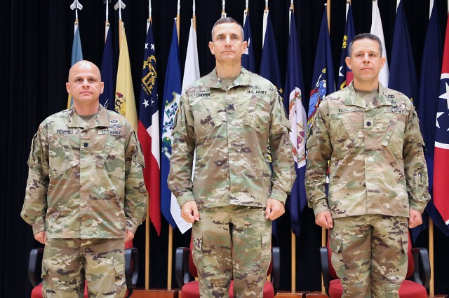 Lt. Col. Marcus D. Perkins, left, new commander of the U.S. Army Medical Materiel Center-Korea, stands with Col. Derek C. Cooper, center, and Lt. Col. Marc R. Welde. Cooper, commander of the 65th Medical Brigade, served as the stand in for Col. Michael Lalor, commander of Army Medical Logistics Command, during a Change of Command ceremony on June 18 at Camp Carroll.