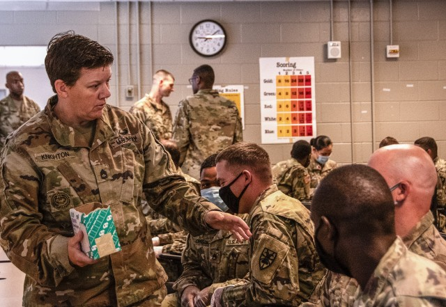 Sgt. 1st Class Jessica Knighton (left) with the 128th Aviation Brigade, communicates with Soldiers participating in an equal opportunity leaders course at Fort Eustis, Virginia, June 23, 2020. The course is designed to prepare Soldiers to be equal opportunity advisors within their respective units. (U.S. Army photo by David Overson)