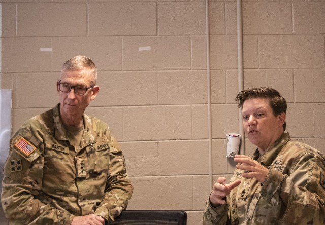 Sgt. 1st Class Jessica Knighton (right) with the 128th Aviation Brigade, informs Lt. Gen. Theodore D. Martin, TRADOC Deputy Commanding General and Chief of Staff, what the Soldiers participating in an equal opportunity leaders course are learning at Fort Eustis, Virginia, June 23, 2020. The course is designed to prepare Soldiers to be equal opportunity advisors within their respective units. (U.S. Army photo by David Overson)