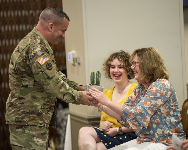 Maj. Gen. Steven A. Shapiro, outgoing commanding general of ASC, presents his wife, Mary, with a cactus during a change of command ceremony held at Rock Island Arsenal, Illinois, on June 24.