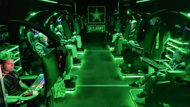 Visitors play video games inside a semitrailer belonging to the U.S. Army Recruiting Command's esports team during the Association of the U.S. Army's Annual Meeting and Exposition in Washington, D.C, Oct. 14, 2019. The command plans to create a cyber esports team and roll out autonomous recruiting operations, which will increase the mobility of recruiters with a larger social media presence.