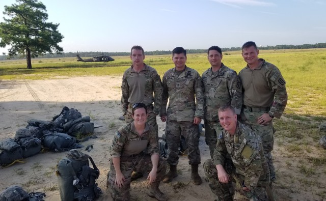 Capt. Katie Nisbet, front left, with several members of the 722nd Explosive Ordnance Disposal Company at Fort Bragg, N.C., July 31, 2019.