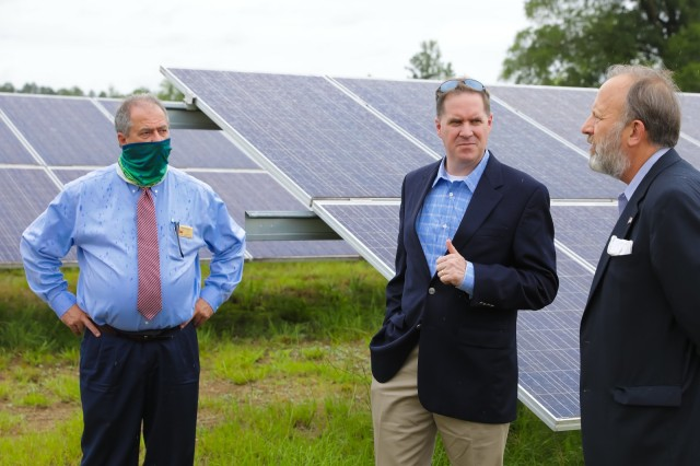 FORT BENNING, Ga. – At a 216-acre solar farm on Fort Benning June 25, Bryan M. Gossage (center) principal deputy assistant secretary of the Army for installations, energy and environment, and Jack Surash (right), acting deputy assistant secretary of the Army for energy and sustainability, get filled in on energy-related matters. With them is Mark Fincher, operations and maintenance chief with U.S. Army Garrison Fort Benning's Directorate of Public Works (DPW). The stop was one of several during a visit Gossage and Surash made for insight into the post's efforts with renovation of Family homes and Soldier barracks, energy initiatives, and other key matters.(U.S. Army photo by Markeith Horace, Maneuver Center of Excellence and Fort Benning Public Affairs)