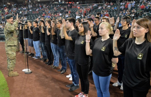 Lt. Col. Scott Morley, commander of the Phoenix Recruiting Battalion, administers the oath of enlistment to 40 future Soldiers, Aug. 26, 2018, at Chase Field before an Arizona Diamondbacks game. U.S. Army Recruiting Command plans to soon launch Army National Hiring Days, a major hiring event from June 30 to July 2, 2020, that aims to place 10,000 more recruits in boots.