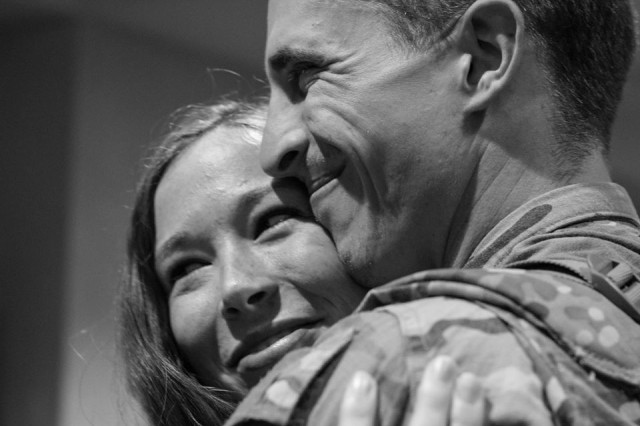 Then 1st Lt. Jacob Henry is greeted by his wife Jenna upon returning from his  second deployment to the Middle East with the 1st Battalion, 66th Armor Regiment in 2015.