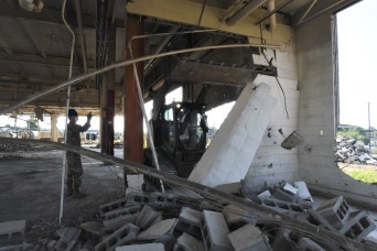 502nd Bridge Company demolishes two buildings to make space for equipment