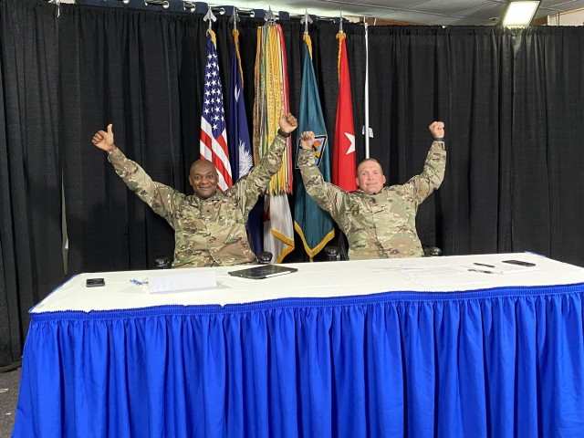 Brig. Gen. Milford H. 'Beags' Beagle Jr., Fort Jackson commander, and Post Command Sgt. Maj. Jerimiah Gan celebrate after the end of a virtual town hall June 18. It was Gan's last town hall as the post's senior enlisted leader. (Courtesy Photo)