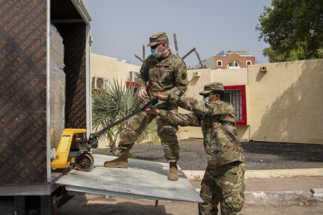 U.S. Army Maj. Jonathan Holliday (left), bilateral affairs officer, U.S. Embassy to Djibouti, and U.S. Army Staff Sgt. Mackenzie Vilme (right), team sergeant, Alpha Company, 443rd Civil Affairs Battalion (CA BN), Combined Joint Task Force-Horn of Africa (CJTF-HOA), unload hygiene supplies to assist Djibouti prevent COVID-19 infections among hospital staff and its citizens at Djibouti City, Djibouti, June 10, 2020. CJTF-HOA worked to purchase the supplies, valued at approximately $15,000, using Overseas Humanitarian, Disaster, and Civic Aid Appropriation (OHDACA) funds after the Djibouti government made a formal request for assistance to the U.S. Embassy. (U.S. Air Force photo by Senior Airman Gage Daniel)
