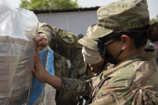 U.S. Army Capt. Dawn Carter (left), team chief, Alpha Company, 443rd Civil Affairs Battalion (CA BN), Combined Joint Task Force-Horn of Africa (CJTF-HOA), and U.S. Army Sgt. Alexis Peine (right), team medic, 443rd CA BN, label hygiene supplies to assist Djibouti prevent COVID-19 infections among hospital staff and its citizens at Djibouti City, Djibouti, June 10, 2020. CJTF-HOA worked to purchase the supplies, valued at approximately $15,000, using Overseas Humanitarian, Disaster, and Civic Aid Appropriation (OHDACA) funds after the Djibouti government made a formal request for assistance to the U.S. Embassy. (U.S. Air Force photo by Senior Airman Gage Daniel)
