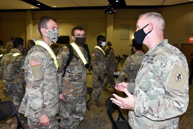 Maj. Gen. Dennis LeMaster, Commander, U.S. Army Medical Center of Excellence, speaks to AIT soldiers during the MEDCoE Army National Hiring Days Soldier Forum on June 26, 2020 at Joint Base San Antonio-Fort Sam Houston, Texas. Spread out through several sessions that adhere to COVID-19 countermeasures, the MEDCoE Army National Hiring Days Soldier Forum will reach nearly 600 Soldiers.