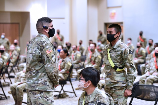 Col. Roman Cantu, 5th Recruiting Brigade, answers a Soldier's question during the MEDCoE Army National Hiring Days Soldier Forum on June 30, 2020 at Joint Base San Antonio-Fort Sam Houston, Texas. Spread out through several sessions that adhere to COVID-19 countermeasures, the MEDCoE Army National Hiring Days Soldier Forum reached nearly 600 soldiers.