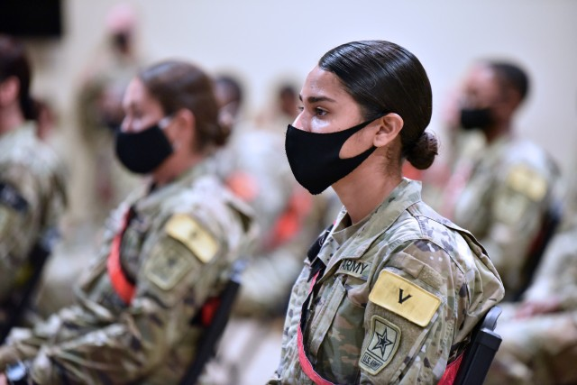AIT Soldiers wearing face masks listen to Maj. Gen. Dennis LeMaster, Commander, U.S. Army Medical Center of Excellence during the MEDCoE Army National Hiring Days Soldier Forum on June 30, 2020 at Joint Base San Antonio-Fort Sam Houston, Texas. Spread out through several sessions that adhere to COVID-19 countermeasures, the MEDCoE Army National Hiring Days Soldier Forum will reached nearly 600 soldiers.