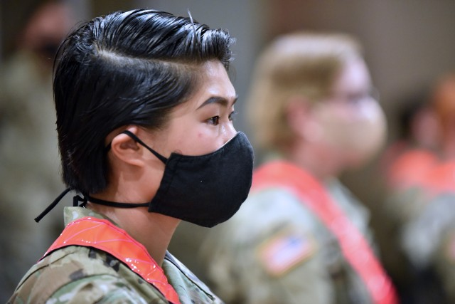 Pvt. Meiling Durzinsky, who is in Advanced Individual Training at the MEDCoE, to become a 68T Animal Care Specialist, listens to the presentation during the MEDCoE Army National Hiring Days Soldier Forum on June 30, 2020 at Joint Base San Antonio-Fort Sam Houston, Texas. Spread out through several sessions that adhere to COVID-19 countermeasures, the MEDCoE Army National Hiring Days Soldier Forum reached nearly 600 soldiers.