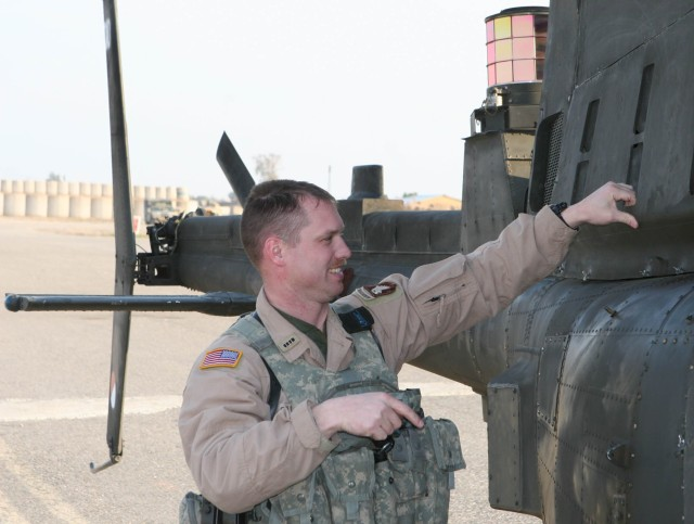 Chief Warrant Officer Brian Stoner, an OH-58D Kiowa Warrior armed reconnaissance helicopter pilot in 2nd, Squadron, 17th Cavalry Regiment, does some post-flight checks following a flight Feb. 22 on Forward Operating Base Warrior by Kirkuk, Iraq. Stoner, who went from high school to flight school, has flown Army helicopters for 18 years.