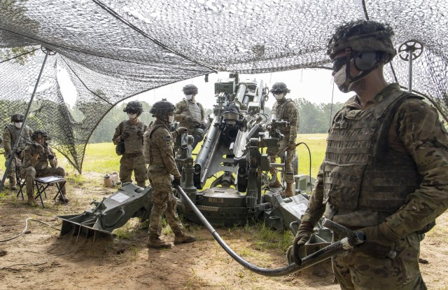 U.S. Army cannon crewmembers assigned to Charlie Battery, 5th Battalion, 25the Field Artillery Regiment, 3rd Brigade Combat Team, 10th Mountain Division, rehearse crew drills at Slagle training area, Fort Polk, Louisiana, prior to a firing a M982A1 Excalibur precision munition from a M777 howitzer, June 27, 2020. The training certified C BTRY to provide live fire artillery support to Joint Operations Training Center rotational training units. (U.S. Army photo by Staff Sgt. Ashley M. Morris)