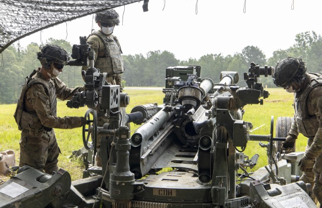 U.S. Army cannon crewmembers assigned to Charlie Battery, 5th Battalion, 25the Field Artillery Regiment, 3rd Brigade Combat Team, 10th Mountain Division, prepares a M777 howitzer for low-angle fire at Slagle training area, Fort Polk, Louisiana, prior to a firing a M982A1 Excalibur precision munition, June 27, 2020. The training certified C BTRY to provide live fire artillery support to Joint Operations Training Center rotational training units. (U.S. Army photo by Staff Sgt. Ashley M. Morris)