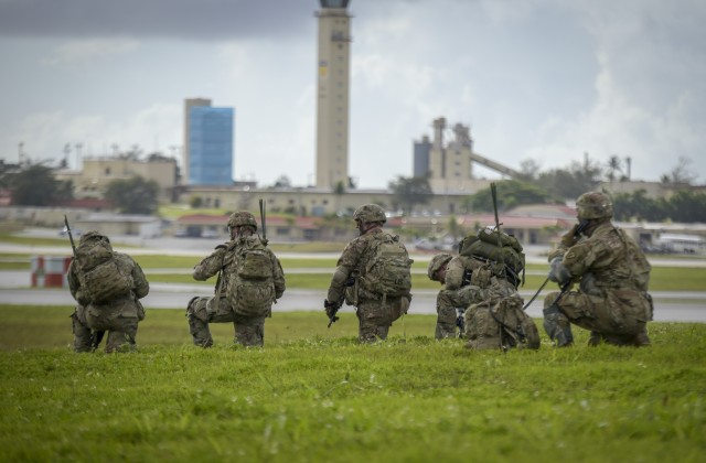 Paratroopers of the 4th Infantry Brigade Combat Team (Airborne), 25th Infantry Division, U.S. Army Alaska, demonstrate a joint forcible entry into Andersen Air Force Base, Guam, June 30. The Army's airborne brigade provides the Joint force the capability to rapidly deploy to and seize contested territory. The Joint force underpins United States' commitment to the security and stability in the Indo-Pacific region and demonstrates the ability to safely conduct operations in a COVID-19 environment. (U.S. Air Force photo by Staff Sgt. Divine Cox)