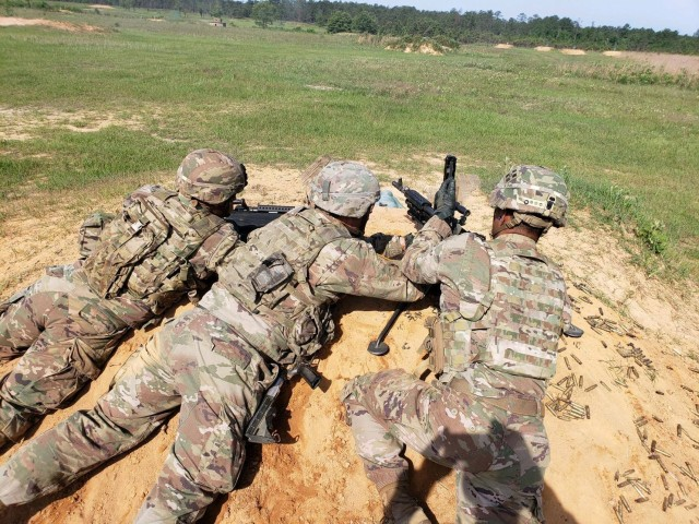 FORT BENNING, Ga. – In an August 2019 photo, Soldiers attending the Henry Caro Noncommissioned Officer Academy as students in its Infantry Advanced Leader Course take part in machine gun training in which students must maneuver their weapons squads as they would in combat. As the academy prepares for the arrival of hundreds of new students this month, it's launching a rigorous set of precautions to limit the risk of COVID-19 exposure. Those include COVID-19 nasal swab testing for each student newly arrived for class, restricting entry to school grounds, placing limits on students' movements, and rigorous cleaning of classrooms six times daily, among other measures. The school is part of the U.S. Army Maneuver Center of Excellence, and trains Infantry and Armor noncommissioned officers.(U.S. Army photo courtesy of Henry Caro Noncommissioned Officer Academy)