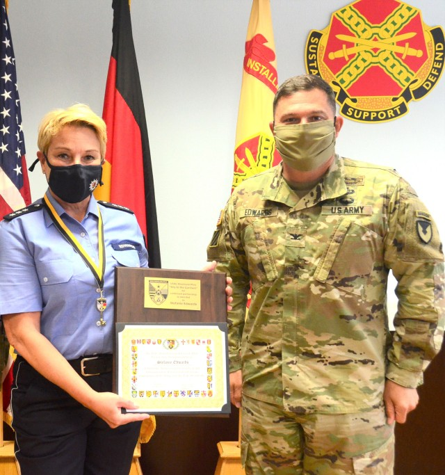 Stefanie Edwards, Landstuhl Police Liaison Officer, poses with Col. Jason Edwards, U.S. Army Garrison Rheinland-Pfalz commander, after Edwards presented her with a Key to the Garrison in a small ceremony in late June.