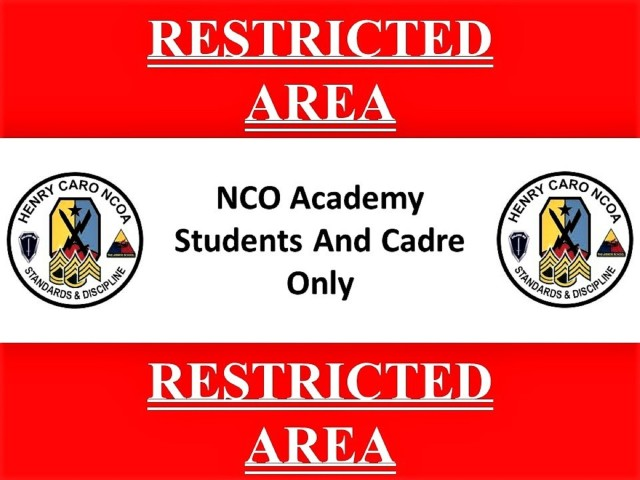 FORT BENNING, Ga. – Officials of the Henry Caro Noncommissioned Officer Academy here plan to place this sign around the school's perimeter and post guards at key locations as part of their all-out effort to shield – to the extent possible – the academy's students and cadre from exposure to COVID-19. Other precautions include COVID-19 nasal swab testing for 100 percent of students newly arrived for class, limiting group sizes to 16 students, rigorous cleaning of classrooms six times daily, and placing limits on student movements, among other measures. The academy is part of Fort Benning's U.S. Army Maneuver Center of Excellence, and trains Infantry and Armor noncommissioned officers.(U.S. Army photo courtesy of Henry Caro Noncommissioned Officer Academy)