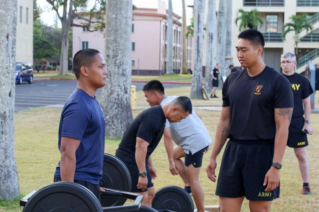 A group of future Soldiers take their turn performing deadlifts during an event on Schofield Barracks, Hawaii in support of the Army National Hiring Days Campaign on June 30, 2020. The event had units from across the installation demonstrate current physical fitness routines, the utilization of the Engagement Skills Trainer, what the division Lightning Academy has to offer, and more. (U.S. Army photo by Staff Sgt. Alan Brutus)