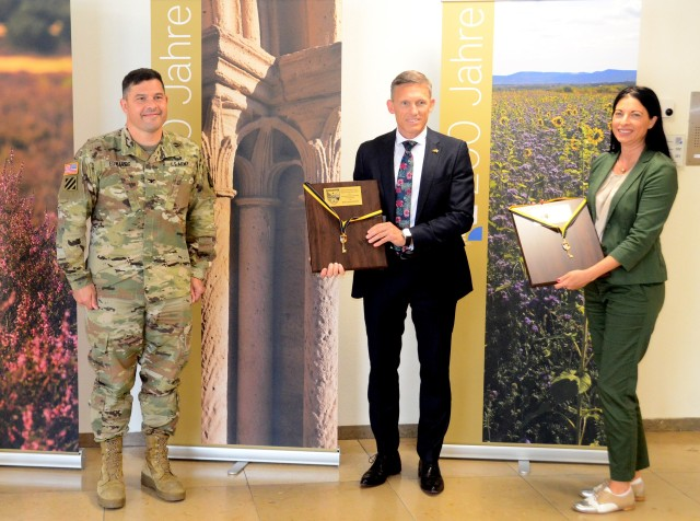 Ralf Lessmeister, Kaiserslautern County Commissioner, middle, and Anja Pfeiffer, Union Community Mayor of Weilerbach, right, pose with Col. Jason Edwards, U.S. Army Garrison Rheinland-Pfalz commander, after Edwards presented Keys to the Garrison to them in a small ceremony in late June.