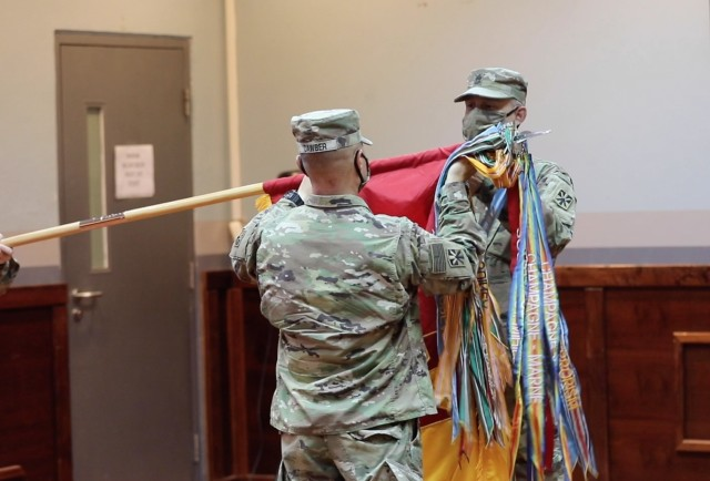 Col. John Dawber (left) and Command Sgt. Maj. James Brazill uncase the Imperial Brigade Colors as the 11th Air Defense Artillery Brigade assumed authority as Top Notch Brigade during a Transfer of Authority ceremony at Al Udeid Air Base, Qatar, June 14, 2020.