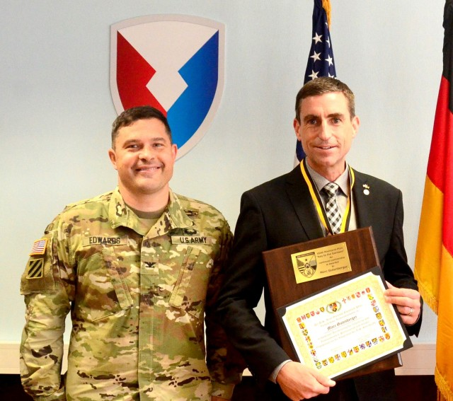 Marc Gutenberger, Chief of U.S. Construction Program with ABB state agency, right, poses with Col. Jason Edwards, U.S. Army Garrison Rheinland-Pfalz commander, after Edwards presented him a Key to the Garrison in a small ceremony in late June.