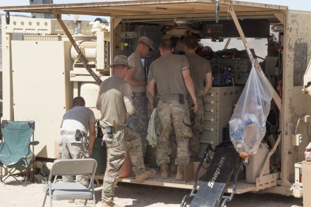 Mechanics from the B Company 145th Brigade Support Battalion reorganize the tools in their M7 Forward Repair System after completing a job at the National Training Center (NTC) in Fort Irwin, Calif., June 10, 2019.  (National Guard photo by Capt. Gregory Walsh, 115th Mobile Public Affairs Detachment)