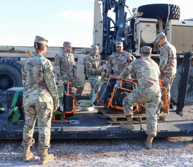 Soldiers from varying brigades and units throughout the 101st Airborne Division (Air Assault), properly secure equipment brought in to the Division Excess Consolidation Point (DECP) to a pallet, Nov. 20, as part of Operations Clean Eagle and Eagle Sweep.