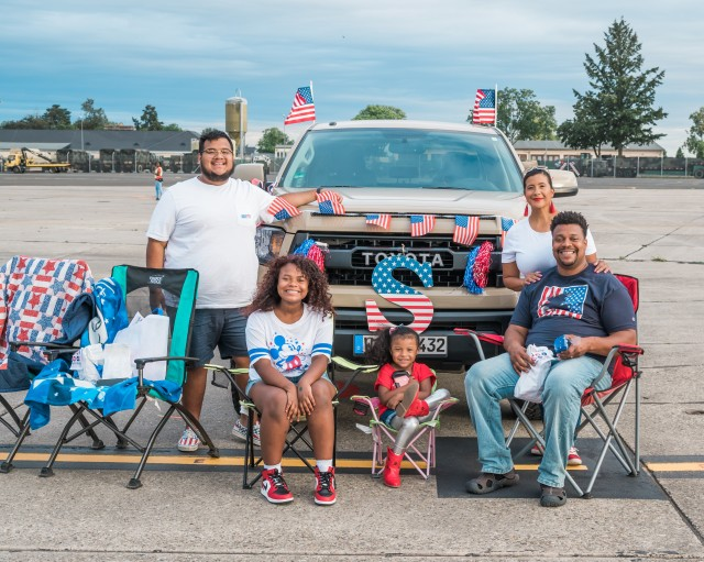 WIESBADEN, Germany - A family arrives early to Wiesbaden Army Airfield to decorate their truck for the Independence Day celebration. They were awarded a USO gift bag for their efforts July 4, 2020.