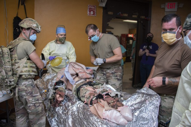Members of the 555th Forward Surgical Team assess a simulated patient during training with Brooke Army Medical Center's Strategic Trauma Readiness Center of San Antonio (STaRC) at Camp Bullis Military Training Reservation, Texas, May 26, 2020. The STaRC training program uses a combination of didactic and hands-on learning to prepare the 555th for deployment. (U.S. Army photo by Jason W. Edwards)