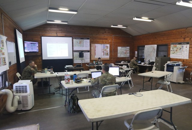 Members of Lt. Col. Adam Sawyer's operations team in the tactical operations center at Camp Buckner prior to the kickoff of Cadet Summer Training. Sawyer is the Department of Military Instruction's chief of Military Science and Training. The TOC at Camp Buckner is where all the information flows through with everything that happens in the field throughout the summer.
