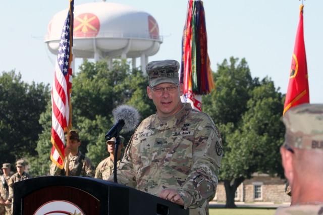 Col. Cobb Laslie speaks at the Army Capabilities Manager, Field Artillery Cannon Battalions, change of charter ceremony July 2, 2020, at the Old Post Quadrangle. FCoE and Fort Sill CG Maj. Gen. Kenneth Kamper praised Laslie and his team for contributing to the success of the Extended Range Cannon Artillery system. Laslie's next assignment won't require difficult travel as he will become the chief of staff of the Long-Range Precision Fires Cross Functional Team here.