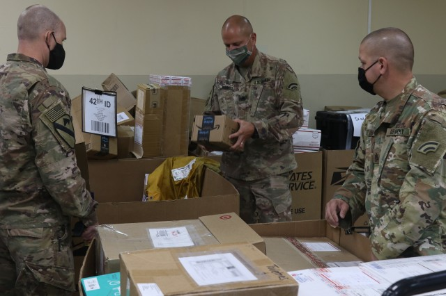 Soldiers with Task Force Spartan work to keep mail operations open while deployed overseas in Kuwait. During Covid-19 with little for soldiers to look forward to mail helps to keep moral up.