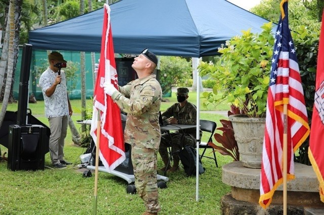 Incoming Pacific Ocean Division Command Sgt. Maj. Douglas Galick prepares to place the division colors during a Change of Command and Responsibility Ceremony on Fort Shafter, Hawaii, July 8.