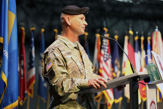 Lt. Gen. Christopher Cavoli, the U.S. Army Europe commanding general, delivers remarks during an assumption of command and assumption of responsibility ceremony July 9 at Kleber Kaserne, Germany.  Cavoli was the presiding officer as Brig. Gen. Mark Thompson took command of Regional Health Command Europe and Command Sgt. Maj. Kyle Brunell assumed responsibility as the RHCE command sergeant major.