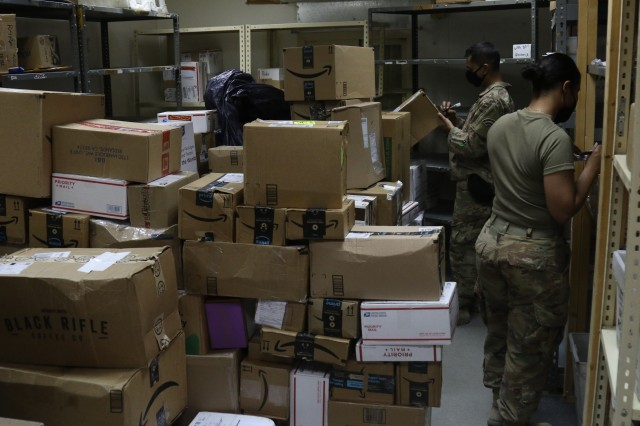 Soldiers with Task Force Spartan work to keep mail operations open while deployed overseas in Kuwait. During Covid-19 with little for soldiers to look forward to mail helps to keep moral up. (U.S. Army Photo by Sgt. Andrew Winchell)