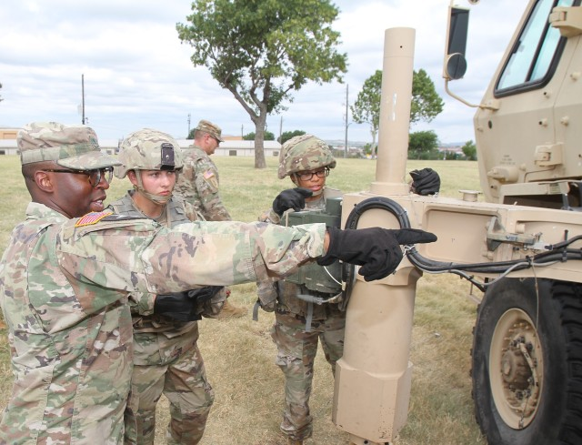 Staff Sgt. Jacory Evans, a 13R Field Artillery Firefinder Radar Operator instructor at Fort Sill, Oklahoma, directs Pvt. Destiny Cole on proper procedures to stow an outrigger arm on the TPQ-53 Counterfire Target Acquisition Radar. 13R Soldiers play a key role on the battlefield detecting and tracking enemy projectiles, and alerting decision makers about these threats.