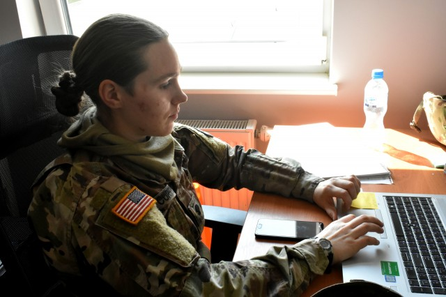Spc. Kimberly Curtis, a unit supply specialist from Helena, Montana is completing administrative tasks for Drawsko Pomorskie Training area as a member of base camp mayor cell.  This mayor cell team is part of the 652nd Regional Support Group, a U.S. Army Reserve unit out of Helena, Montana. The RSG is responsible for providing life-sustaining operations on a military base. This includes every facet of Soldier life, from billeting to laundry and the dining facility.