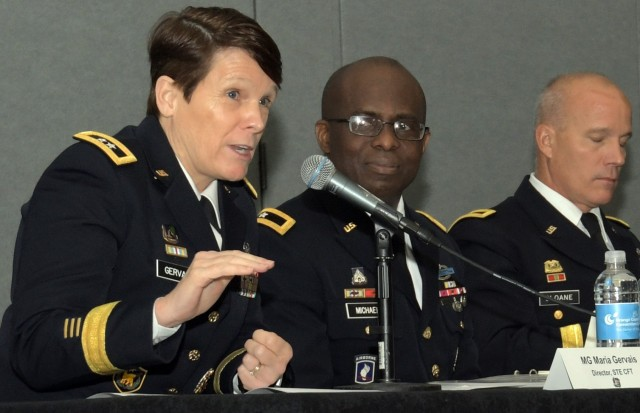 Maj. Gen. Maria Gervais, left, director of the Army's Synthetic Training Environment Cross-Functional Team, speaks about challenges to developing STE at the Interservice/Industry Training, Simulation and Education Conference, Dec. 2, 2019 in Orlando, Florida. Gervais spoke July 9, 2020, during the Austin Dialogue on Innovation in Defense online event on how her team can tap into the innovation of gaming vendors.
