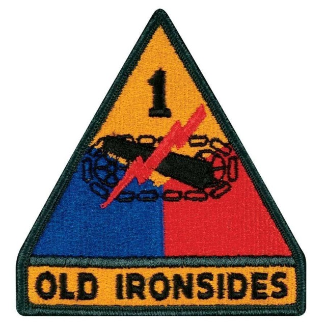 """Fort Bliss, Texas - 1970: Present-day 1st Armored Division Patch Although the """"Old Ironsides"""" nickname had been in use since 1941, the tab was only authorized on Feb. 21, 1956 as a separate item. It was officially attached to the triangular portion on Nov. 5, 1970 to become the one-piece insignia we see today. (Image courtesy of the 1st Armored Division & Fort Bliss Museum)"""