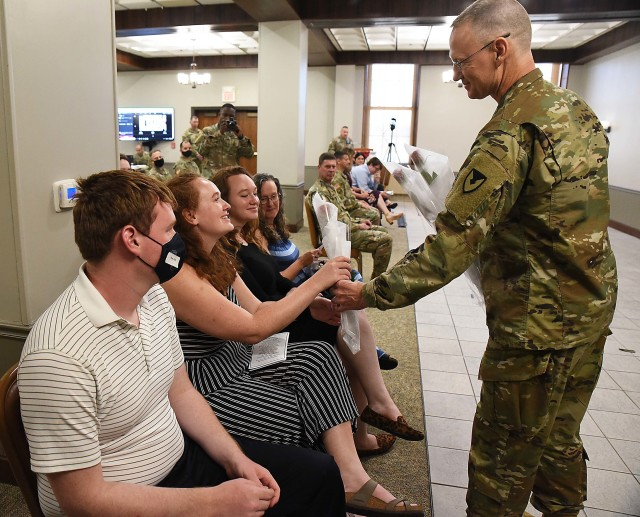 Col. Garrett Kolo, outgoing commander, LOGCAP Support Brigade, gives a rose to his daughter during the LOGCAP Support Brigade change of command ceremony July 10 in Heritage Hall, Rock Island Arsenal, Illinois. (Photo by Jon Micheal Connor, ASC Public Affairs)