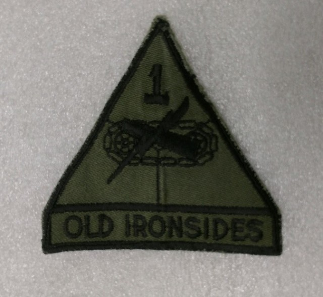 Fort Bliss, Texas - 1967: Early example of the Subdued Patch Although the 1st Armored Division did not participate in the Vietnam War, subordinate units did. The first version of the O.D. (Olive Drab) Green subdued patch for 1st Armored Division was made for 1 Squadron, 1st Cavalry to wear to Vietnam in 1967. The patch was authorized in green and black only for the subdued version and has been used for field uniforms and deployments since that time. Part of the 1st Armored Division & Fort Bliss Museum collection. (Image courtesy of the 1st Armored Division & Fort Bliss Museum)