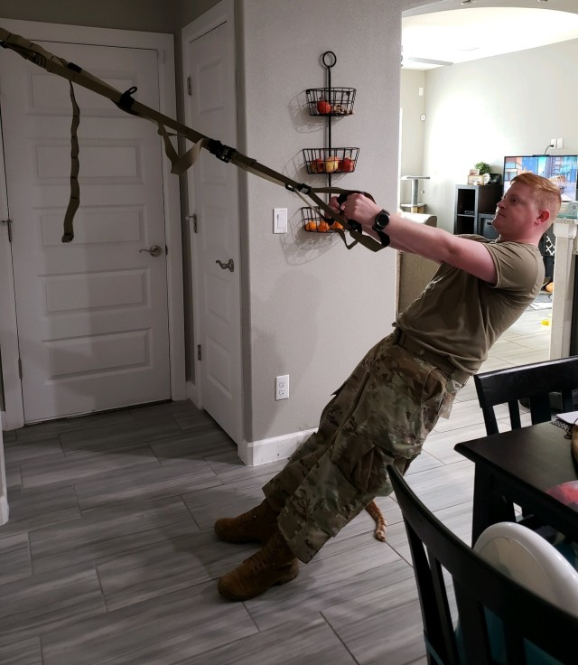 U.S. Army Sgt. Benjamin Davis, a Soldier assigned to the Soldier Recovery Unit at Fort Bliss, Texas, performs an at-home TRX workout. During the COVID-19 pandemic, the adaptive reconditioning program at Fort Bliss has provided virtual at-home body-weight workouts that require little to no equipment. (U.S. Army courtesy photo)