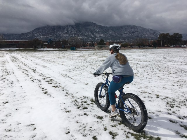 U.S. Army Spc. Jennifer Davenport, assigned to the Soldier Recovery Unit at Fort Carson, Colo., rides a fat tire bicycle through snow. While in the Army Recovery Care Program, she started using a recumbent bike and learned to mountain bike. (U.S. Army courtesy photo)