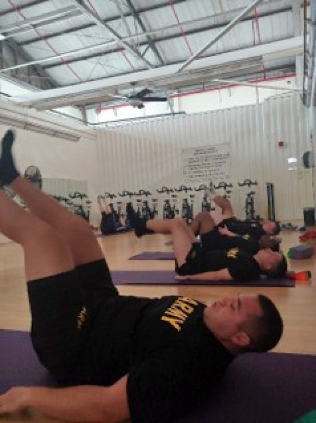 U.S. Army Sgt. Kyle Alejandro, Spc. Quinn Mazepa, Sgt. Jonathan Kennedy, and Spc. Alez Seccia participate in a Pilates class at the Schofield Barracks Soldier Recovery Unit. (U.S. Army courtesy photo)